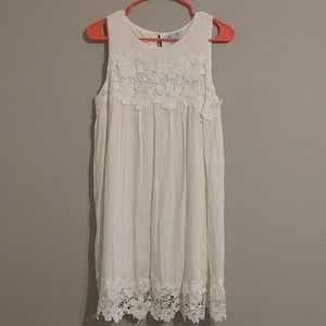 Sleeveless white SHE+SKY dress with floral design